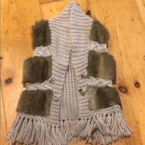 Knit vest.